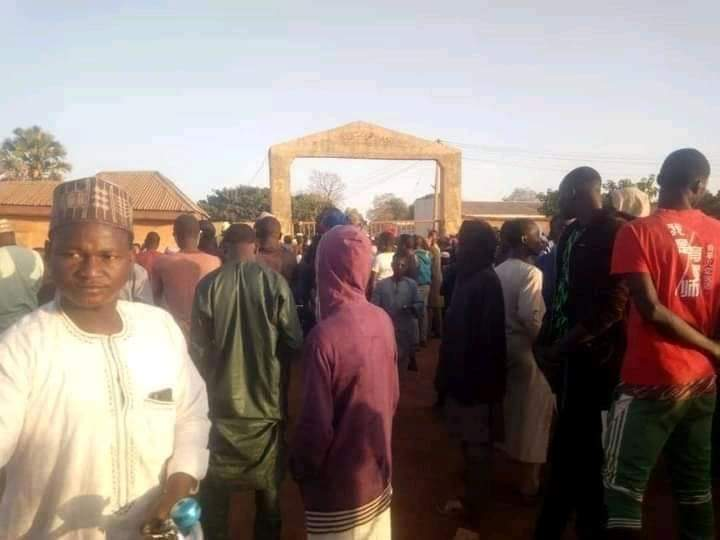 Crowds at the entrance to GSSS Kankara Secondary School