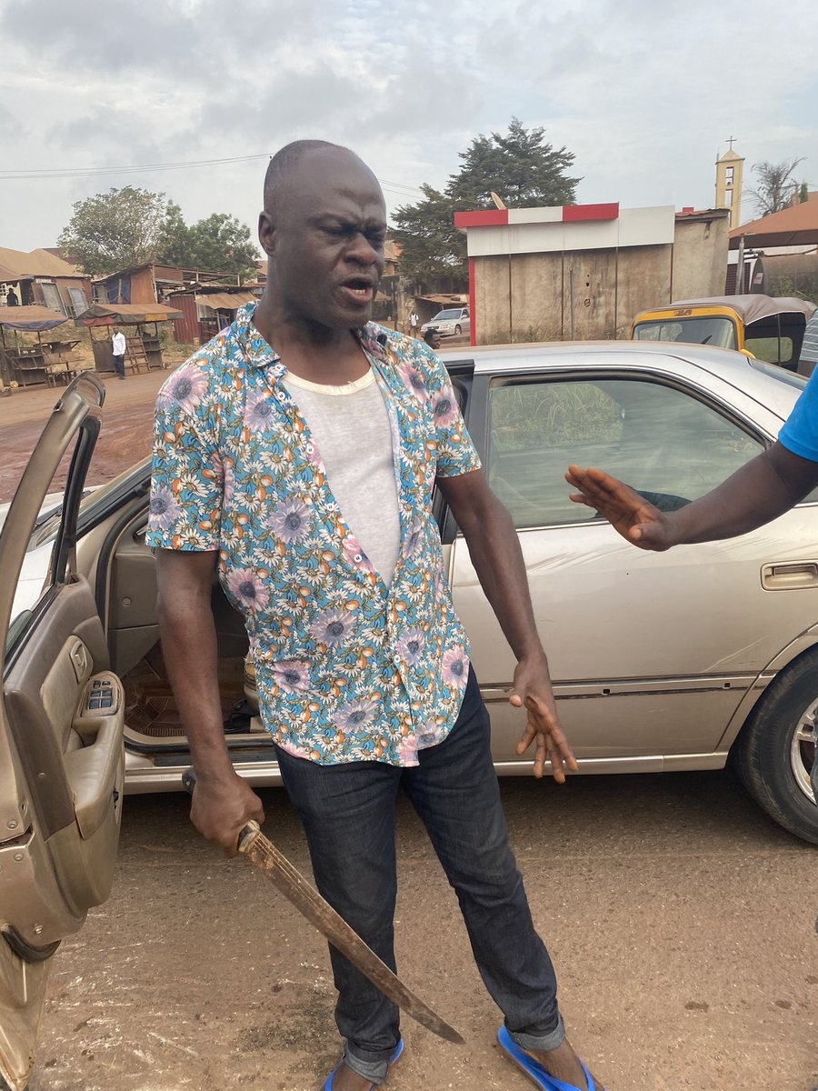 Cutlass Man - Moment 'Frustrated' Man Attempted To Butcher Another Man After Hitting His Car – [Photos]