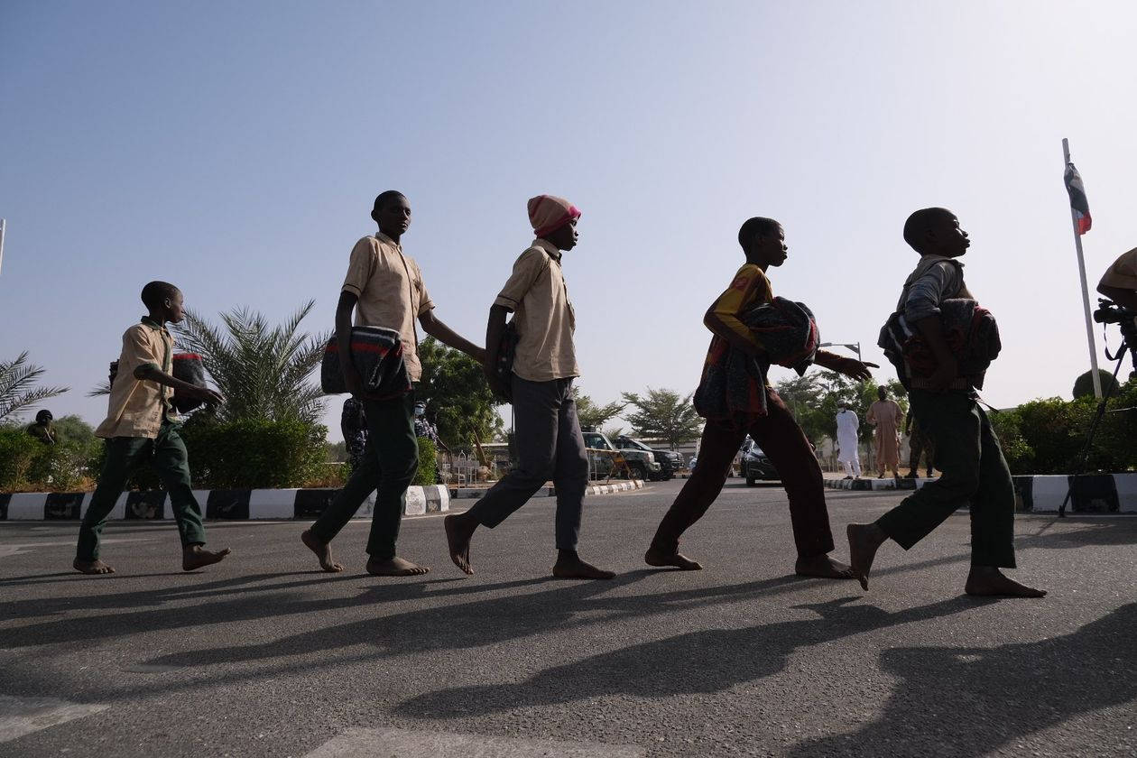 Freed students were led into a government building in Katsina, Nigeria, on Dec. 18.
