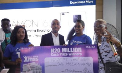 One of the winners being presented with a cheque of 1Million Naira by Small Doctor