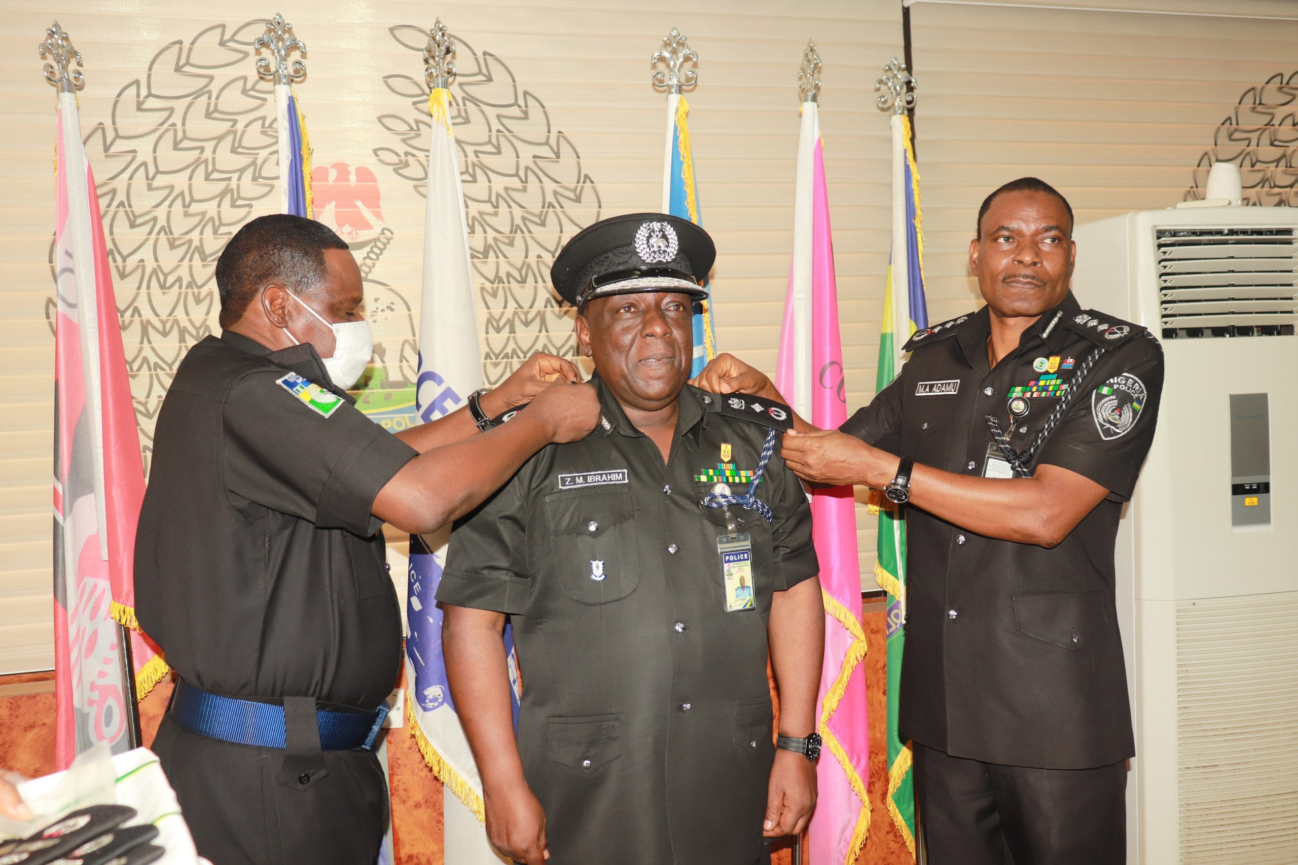 The IGP alongside DIG Training decorating DIG Zanna Ibrahim mni with his new rank scaled - IGP Decorates Newly Promoted DIGs, Deploys Them To New Positions (Photos)