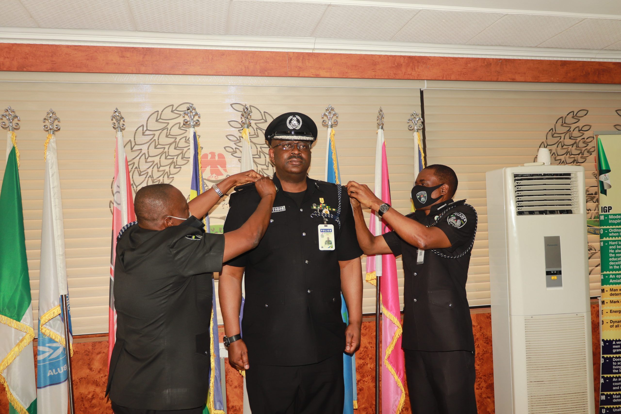 The IGP and the DIG Operations decorating DIG Moses Jitoboh mni with his new rank scaled - IGP Decorates Newly Promoted DIGs, Deploys Them To New Positions (Photos)