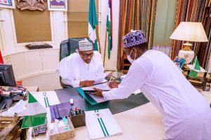 buhari and tunde sabiu 300x200 - Buhari's Nephew Speaks On Appointment As NIA Director