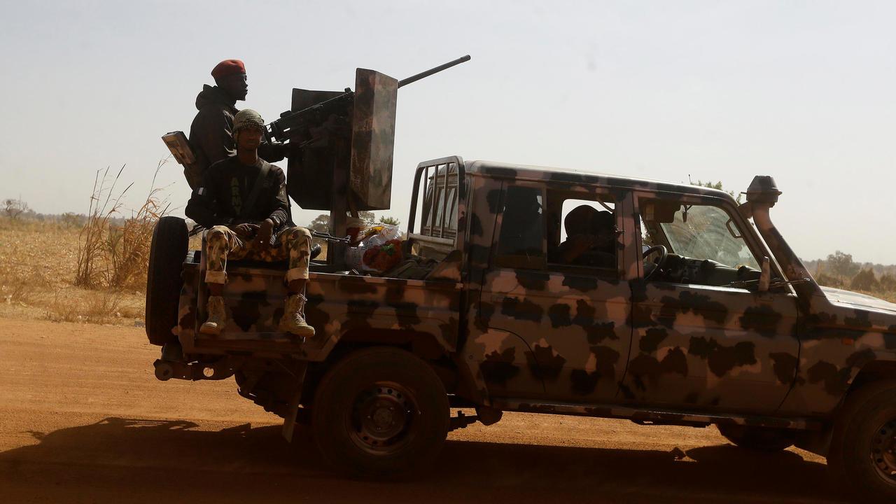 Nigerian soldiers drive past Government Science secondary school in Kankara, Nigeria, Wednesday, December 16, 2020. © Sunday Alamba, AP