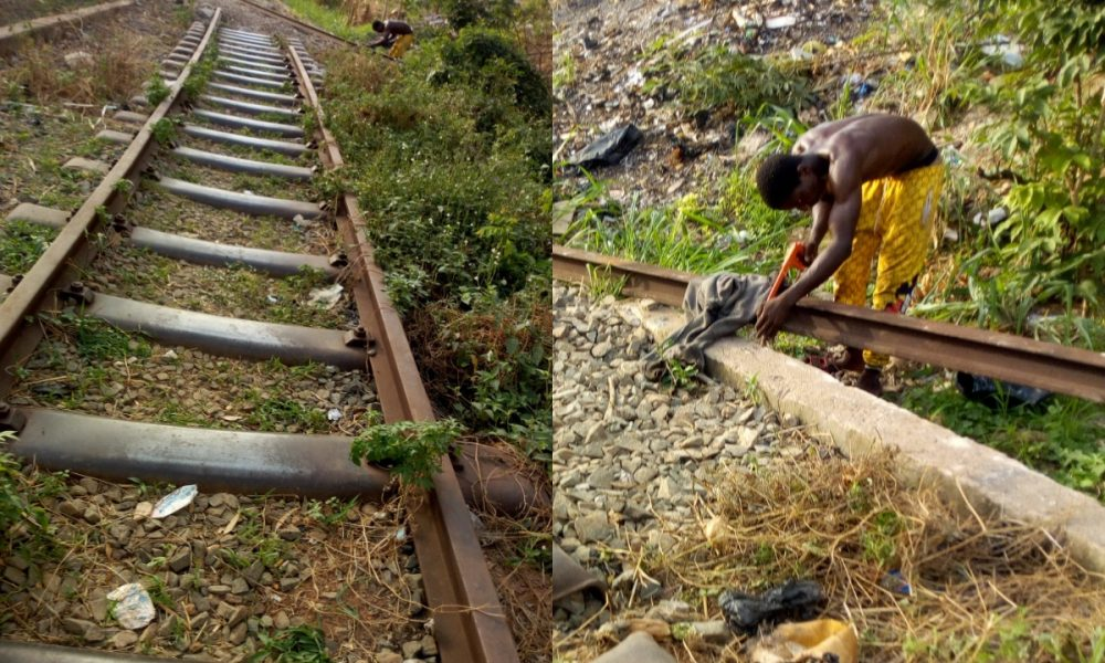 Vandal Spotted Cutting Rail Lines Into Sizes In Enugu
