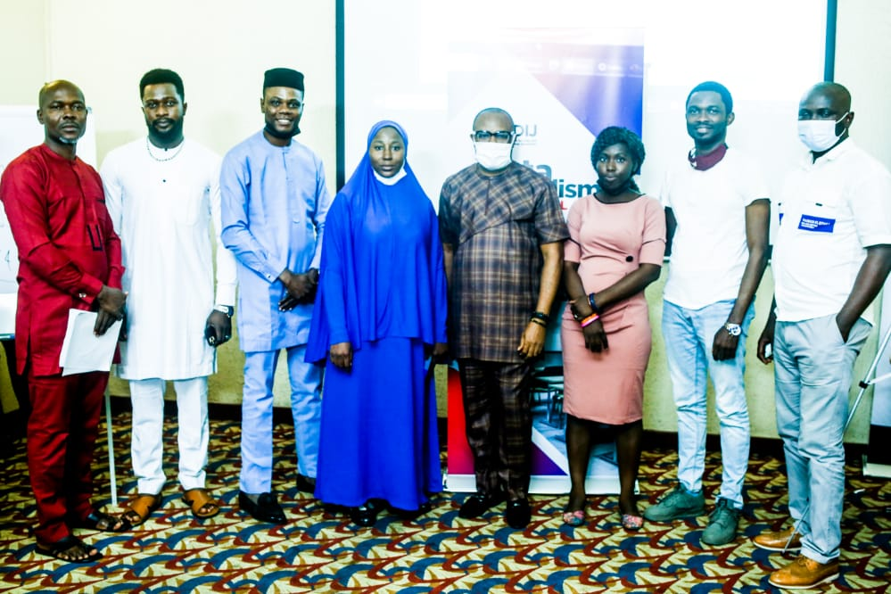 Ripples Nigeria Editor-in-Chief, Samuel Ibemere (m) with some participants.